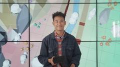 4K Make up artist & floor manager preparing tv presenter before he goes on air Stock Footage