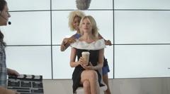 4K Make up artist preparing tv presenter before she goes on air Stock Footage
