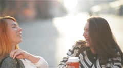 Two beautiful young chic stylish girls having fun outdoors. Attractive young Stock Footage