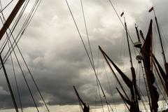 Yacht masts and rigging set against a rain filled sky Stock Photos