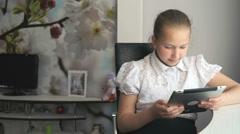 Primary schoolgirl using a digital tablet computer Stock Footage