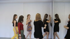 Group of girls quickly quits dancing hall after lesson Stock Footage