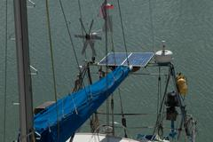Solar charging batteries aboard, sail boat Photovoltaic panels energy concept Stock Photos