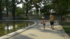 Young Mother Walks in the Centre Park of the City of Opole Stock Footage
