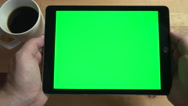 POV Holding Tablet Green Screen with Coffee Cup on Counter. Stock Footage