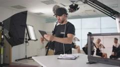 4K TV crew in studio, preparing to go live on air Stock Footage