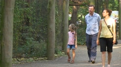 A Little Girl Confidently Striding Forward, Having Forgotten About the Stock Footage