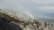 4K bright rainbow over cliff,mountain landscape,fog coming Stock Footage