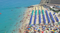 The summer beach, crowded and full of umbrellas Stock Footage