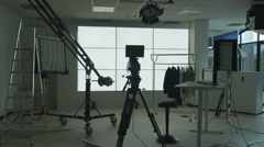4K Time lapse of TV crew in studio, setting up for a shoot & packing away after. Stock Footage