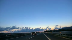 driving on the highway into the sunset Arkistovideo
