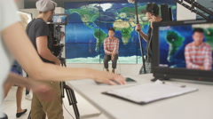 4K TV crew & presenter in studio, preparing to go live on air. Stock Footage