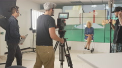 4K Crew member working behind the scenes on TV production set Stock Footage