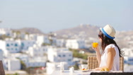 Beautiful elegant girl having breakfast at outdoor cafe with amazing view on Stock Footage
