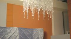 Modern crystal chandelier on fashion ceiling. 4K Stock Footage
