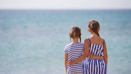 Adorable little girls together during beach vacation Stock Footage