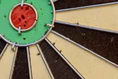 Used dart board with holes from darts and copy space area for sport based des Stock Photos