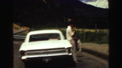 1968: man standing against a car in a scenic place SEATTLE, WASHINGTON Stock Footage