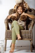 Little cute brunette girl at home interior happy smiling close up, lifestyle Stock Photos