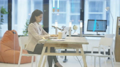 4K Confident successful businesswomen in a meeting looking over paperwork Stock Footage