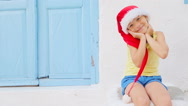 Little girl in red hat outdoors in old street on Mykonos. Kid at street of Stock Footage