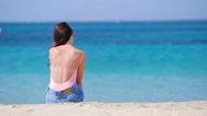 Young beautiful woman on the beach during tropical vacation. Girl enjoy her Stock Footage
