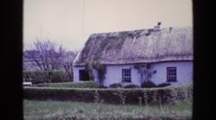 1969: an beautiful, quaint, old english cottage with a thatch roof ENGLAND Stock Footage