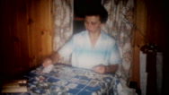 Mom plays solitaire card game on the kitchen table 3641 vintage film home movie Stock Footage
