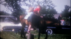 Brother and sister get on the pony for a ride, 3644 vintage home movie Stock Footage