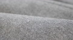 Gathers of grey training shirt or pants fine fabric pattern close-up 4K 2160p Stock Footage