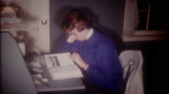 High school girl has homework after dinner 3646 vintage film home movie Stock Footage