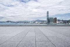 Modern office buildings in hong kong from empty brick floor Stock Photos