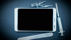 Tablet pc with medical objects on a desk Stock Footage