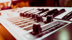 Keyboard of a synthesizer with sliders Stock Footage