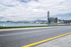 Modern buildings in hong kong from empty road Stock Photos
