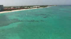 Sailboat Flyover on Seven Mile Beach, Grand Cayman island Stock Footage