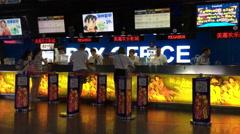 Customers buy film ticket in a cinema Stock Footage