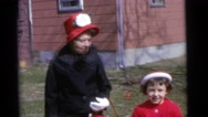 1963: two women, two boys and a girl dressing in their best clothes  Stock Footage