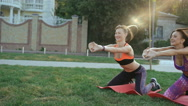 Two girl doing active exercise on the grass in the morning in 4K Stock Footage