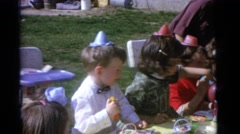 1963: childrens birthday party in a backyard on a sunny day CAMDEN, NEW JERSEY Stock Footage