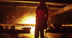 Worker cut hot steel blocks in slow motion Stock Footage