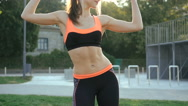 Pretty girl doing exercises with weights outdoor in 4K Stock Footage