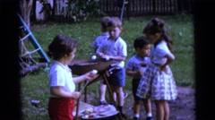 1963: children are seen having fun in a garden area CAMDEN, NEW JERSEY Stock Footage