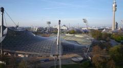 Aerial closeup of Olympia stadium Munich roof Stock Footage