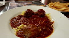 Close up brooklyn spaghetti meatballs and fries on table Stock Footage