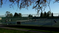 People playing tennis at Queen Elizabeth Park in Vancouver BC Canada. Stock Footage