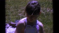 1963: kids smiling and playing in a small pool for children CAMDEN, NEW JERSEY Stock Footage