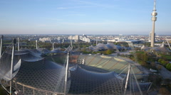 Aerial shot of Munich Olympia stadium, lake and tower Stock Footage