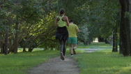 Young couple run on a footpath (slow motion) Stock Footage