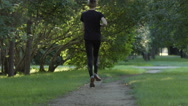 Young man runs on a footpath (slow motion) Stock Footage